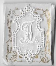 6 Monogrammen L.T.  4,5 x 2,5 cm