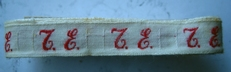 1 Initiaal - Lint T.E.  Lint 1 cm breed