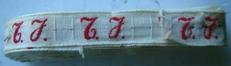 1 Initiaal - Lint T.J.  Lint 1 cm breed