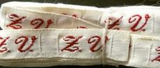 1 Initiaal - Lint Z.V.  Lint 1 cm breed