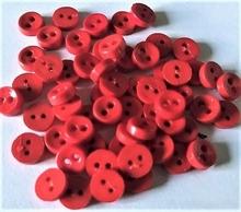 Poppenknoop - oranje  6,5 mm
