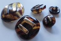 Glasknoop - bruin-goud  26 mm